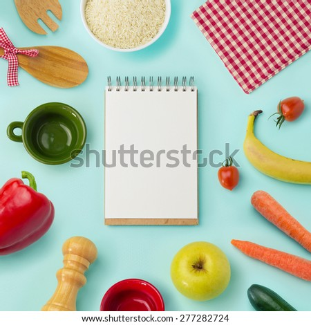 Food background with blank notebook. View from above - stock photo