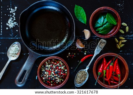 Food background with fresh spices and herbs selection on dark vintage texture. Top view. - stock photo