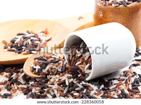 Food background with of rice variety . rice mixture. brown rice, black rice, white rice. - stock photo