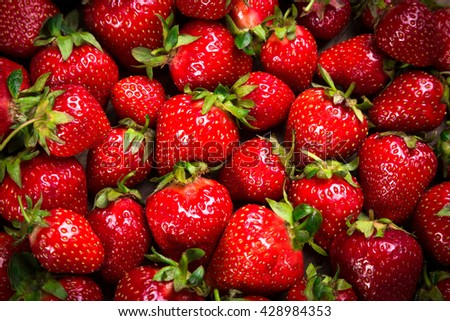 food background with plenty of ripe strawberry, close up