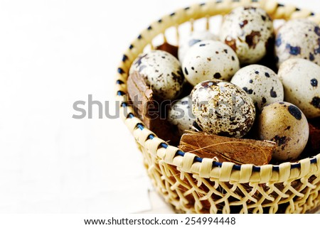 Food background with quail eggs close up over white. Space for text. - stock photo