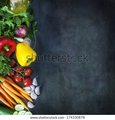 Food background with salad ingredients over dark slate.  Overhead view. - stock photo