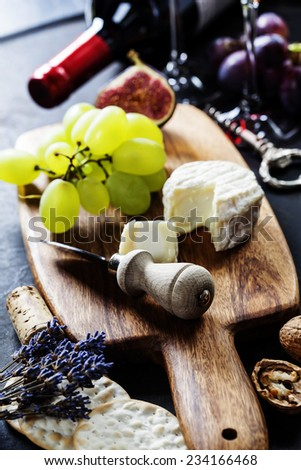 Food background with Wine, cheese and Grape. - stock photo