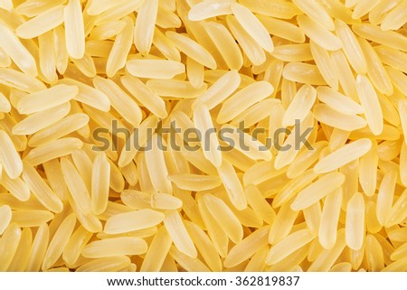 food background - yellow parboiled long grain Indica rice close up