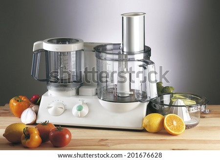 food blender with fruit and vegetable around - stock photo