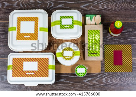 Food boxes and wooden cutlery on the table - stock photo