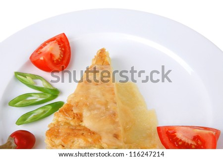 food : cheese casserole piece on white plate served with parsley and tomatoes isolated over white background