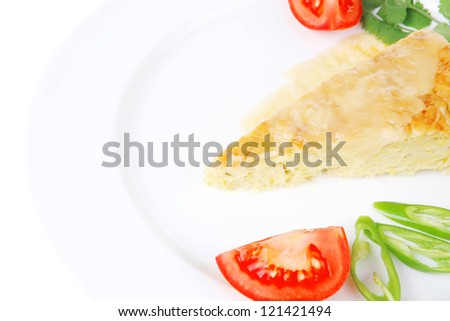 food : cheese casserole piece over white plate served with peppers and tomatoes isolated over white background