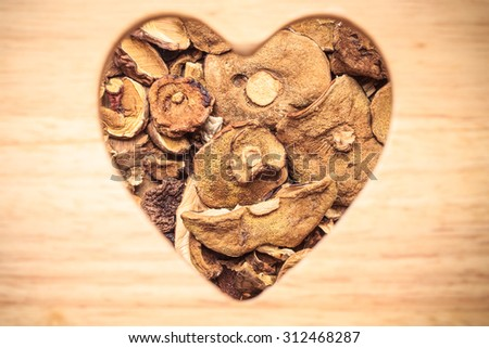 Food. Closeup dry mushrooms boletus heart shaped