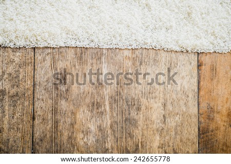 Food Collection theme uncooked rice and wooden textures background - stock photo