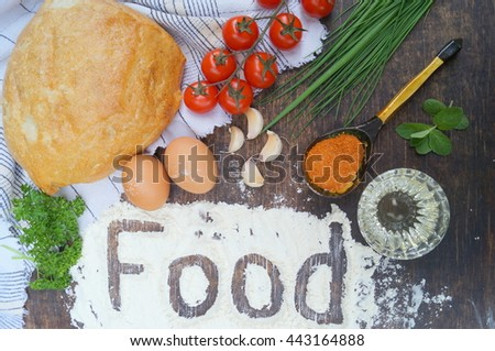 Food composition. Bread, tomatoes, eggs, butter, flour, onion, garlic, parsley, spices. - stock photo