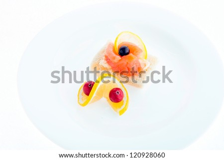 Food composition of sandwiches with butter, salmon and red caviar