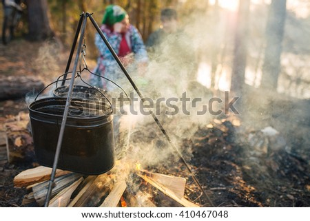 Food cooking over a campfire - stock photo