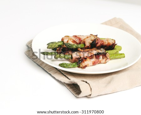 Food. Delicious asparagus with bacon