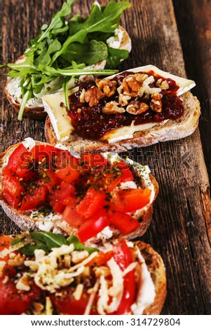 Food. Delicious tapas appetizers on the table - stock photo