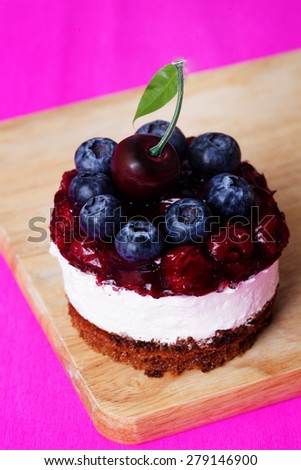 food dessert cupcakes with cherry and blueberry jam berry cream appetizing delicious pleasure - stock photo
