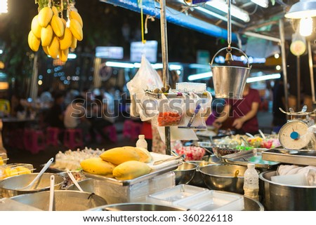 Food detail vendor in Khao San Road, famous low budget hotels and guesthouses area in Bangkok, Thailand. - stock photo