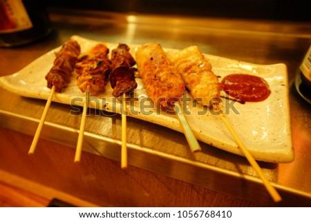 https://thumb1.shutterstock.com/display_pic_with_logo/167494286/1056768410/stock-photo-food-drink-in-izakaya-in-tokyo-1056768410.jpg