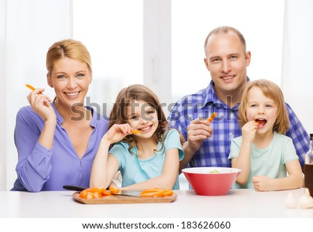 food, family, children, hapiness and people concept - happy family with two kids eating at home - stock photo