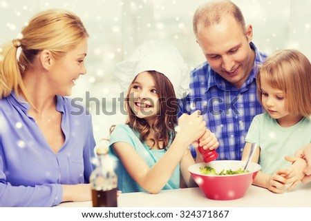 food, family, children, happiness and people concept - happy family with two kids making salad for dinner at home