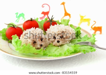 Food for children, two funny rice hedgehogs on the white background