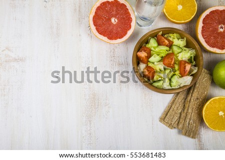 Food for diet  on a wooden table. Concept of diet and healthy lifestyle.