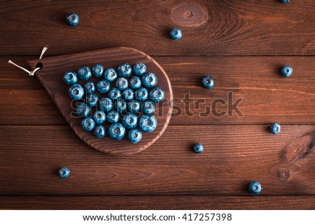 food, fresh blueberry on cutting board, flat lay, top view - stock photo