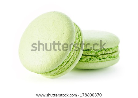 Food: group of fresh green macarons, isolated on white background - stock photo