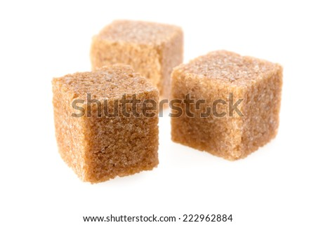 Food: group of three cane sugar cubes, isolated on white background - stock photo