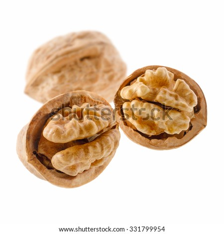Food: group of walnuts, isolated on white background - stock photo