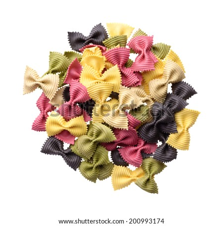 Food: heap of uncooked multicolor farfalle pasta, isolated on white background - stock photo