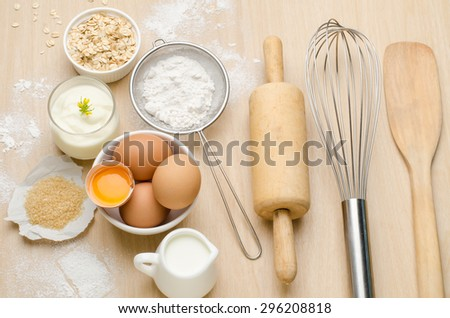 Food ingredient and recipe for backing (cake,dessert,sweet),kitchen utensil and tool on wooden background - stock photo