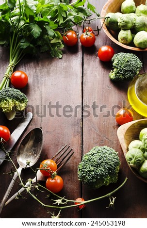 Food ingredients arranged on wooden table with copyspace - stock photo