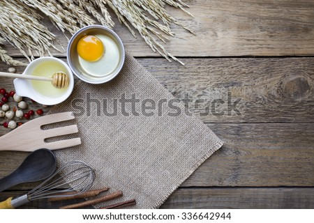Food ingredients , kitchen utensils and tablet for cooking on wooden background - stock photo