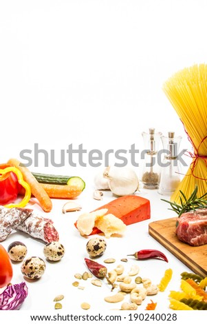 Food ingredients scattered around the white background. Isolated with light shadow. Restaurant menu concept - stock photo
