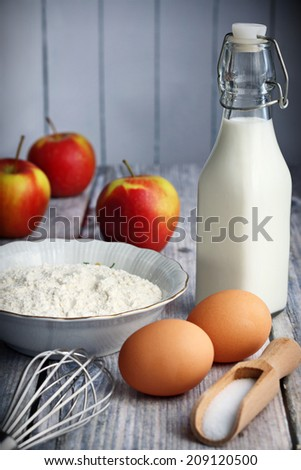 Food ingredients to make American style pancakes with apples including flour, milk, eggs