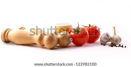 Food ingredients with tomatoes and garlic - stock photo