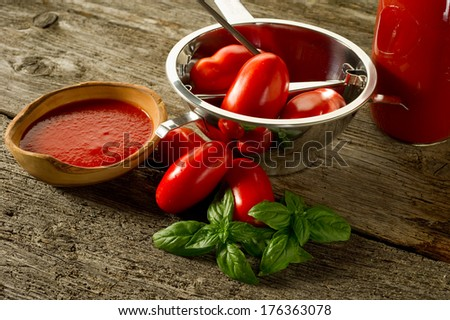 food mill with tomatoes and sauce - stock photo