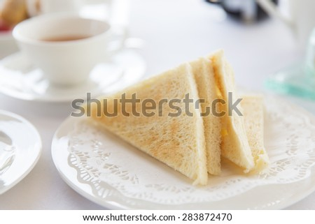 food, morning and eating concept - close up of toasted white bread on plate at breakfast on table - stock photo