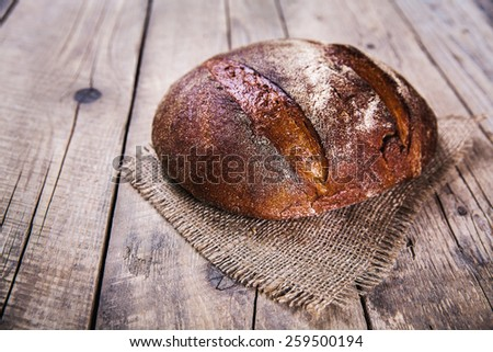 food, nice rye bread on a wooden background - stock photo