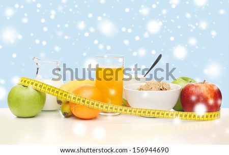 food, nutrition, slimming, diet concept - healthy breakfast and measuring tape - stock photo