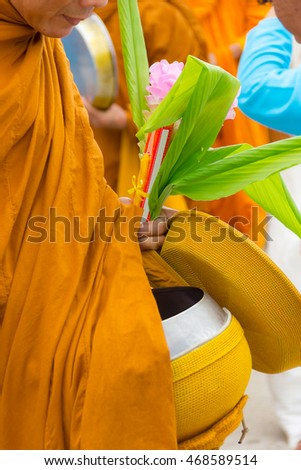 Food offering to a monk.