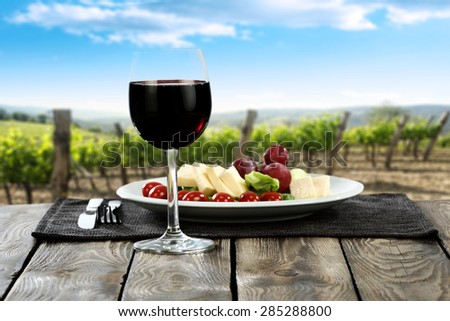food on plate and wine