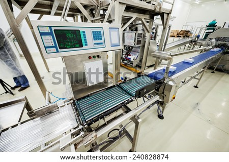 food packing and sorting industry equipment - stock photo