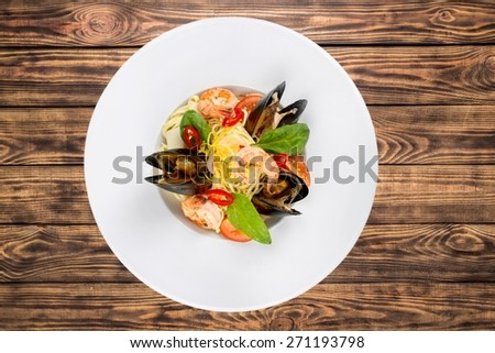 Food. Pasta with mussels and basil - stock photo