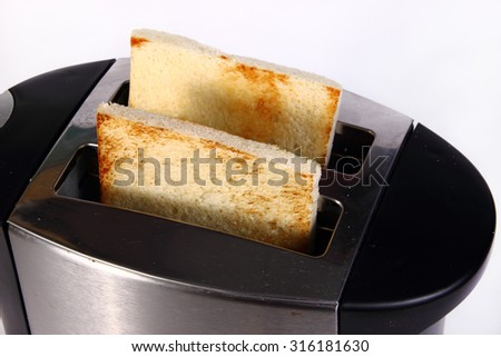 Food photography closeup photo of bread toast in toaster machine