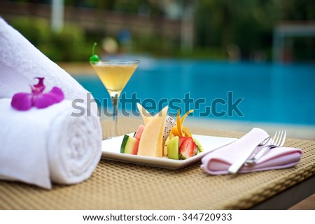 Food Plater with drinks on vacation at the swimming pool
