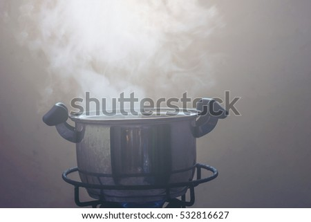 Food pot with steam in the dark