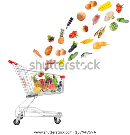 Food products flying out of shopping cart isolated on white - stock photo