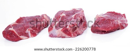 Food. Raw steak on the table - stock photo